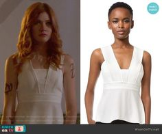 f2b252def589 Clary s white peplum top with back slit on Shadowhunters. Outfit Details   https