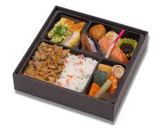 a box lunch sold at a railroad station... http://www.manyouken.co.jp/ekiben/lineup.html ... http://www.manyouken.co.jp/ekiben/img/002_2.jpg