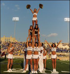 The TU Hurricane cheer squad showing off a cool multiperson pyramid!