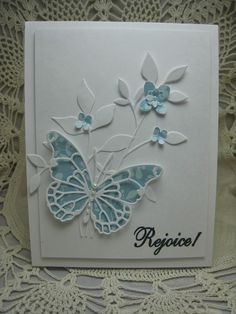 handmade card created by bjk ... aqua and white ... gorgeous layered Vivienne Butterfly by Memory Box ... die cut leaves and little flowers ... delightful card!