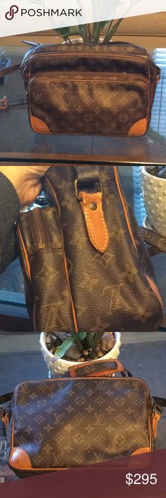 Authentic LV Nile shoulder bag See pics. Some cracks on strap..Minor stains and rubs. Metal parts are tarnish.Zipper works well. Pipings are good. Fully functional bag. Louis Vuitton Bags Shoulder Bags