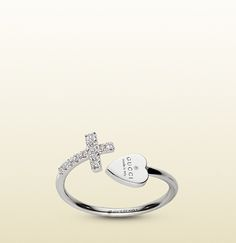 Gucci - ring with cross and gucci trademark engraved heart. 272773J85409066