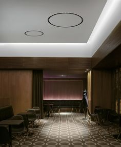 Circle of Light by FLOS Architectural creates a beautiful brightness for this formal setting - creating the perfect view for seated guests with no glare.