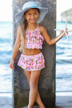 Your little beach cutie can splash the day away in style with this bright and trend-right swimsuit. This two-piece swimsuit carry rash guards for extra sun protection. Wear it with sun hat to get her ready for for pool party.  #shopping #fashion #style #swimsuits #online #shopping #swimset Unique Swimsuits, Two Piece Swimsuits, One Piece Swimsuit, Pink Swimsuit, Bra Styles, Kids Wear, Fashion Prints, Bathing Suits, Sun Protection