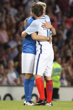 Louis and Niall meet at the Soccer Aid and are competing against each other