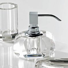 Stylish high-end modern luxurious designer free standing countertop soap dispenser in clear crystal.