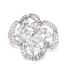 PLATINUM AND DIAMOND BROOCH, MOUNTED BY CARTIER.  The openwork stylized flowerhead brooch set with a marquise-shaped diamond weighing approximately .95 carat, pear-shaped diamonds weighing approximately 10.00 carats, and round, single-cut and baguette diamonds weighing approximately 7.25 carats, signed MTD Cartier.  With signed box.