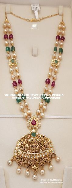 Presenting here is Pearls and Ruby/Emeralds beads chain with nakshi work laxmiji locket studded with pacchi czs and rubies/ emeralds in Hallmarkgold at Wholesale prices. SriMahalaxmiJewellers LongHarram 21 May 2019 Pearl Necklace Designs, Jewelry Design Earrings, Gold Earrings Designs, Gold Jewellery Design, Pendant Jewelry, Beaded Jewelry, Pearl Jewelry, Gold Necklace, Fancy Jewellery