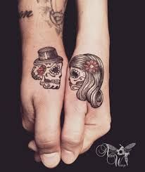 Loving his and hers sugar skull tattoos. Most BOO-tiful Halloween tattoos are he… Loving his and hers sugar skull tattoos. Most BOO-tiful Halloween tattoos are here to help you get ready for the most terrifying day of the year! Tatto Skull, Skull Couple Tattoo, Couple Tattoos Love, Sugar Skull Tattoos, Skull Tattoo Design, Sugar Skulls, Married Couple Tattoos, Sugar Tattoo, Hamsa Tattoo