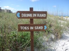 "Wedding Sign Ceremony/Reception Beach Reclaimed Wood ""Drink in Hand"" - ""Toes in Sand"". $42.00, via Etsy."