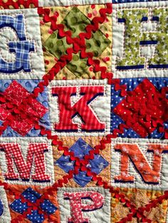 This was a kit from Fat Quarter Shop with the letter's cut from a panel by Holly Holderman from the Dolly Dresses / LakeHouse Dry Goods. The pattern is in the American Patchwork & Quilting magazine from October 2010.