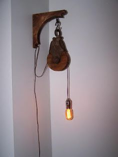 Alamp made from and old barn pulley. With an antique fabric covered cord, and nickel plated socket. finished off with a smoked radio bulb. They don't give off a ton of light, but aesthetically they do the job.