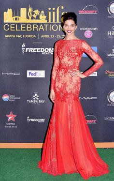 Deepika Padukone was a hands down winner in her red sheer and applique gown by Zuhair Murad on green carpet at #IIFA Awards 2014. #Style #Bollywood #Fashion #Beauty