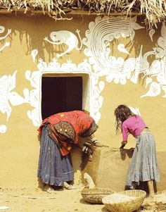 Meena women make mud wall