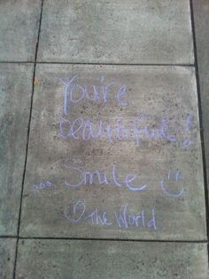 You're beautiful... Smile! <3  - The World. This was my first piece of #pdxchalkart (NW 10th + Northrup) I hope it helped/inspired/brightened someone's life. :)