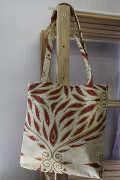 Backside detailing of the Safari inspired bag. Red leaves and white background make a perfect combination.