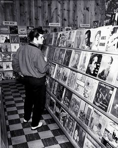 Elvis Presley in a Memphis record shop, 1957.