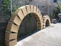 Arches that look like giant gears. Made with cardboard boxes and would be a fantastic, cheap decoration for Maker Fun Factory VBS 2017 Cardboard Crafts, Cardboard Boxes, Cardboard Train, Cardboard Castle, Cardboard Playhouse, Cardboard Sculpture, Cardboard Furniture, Maker Fun Factory Vbs, Stage Props
