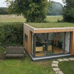 This client loves his garden room sedum roof so much he smiles every day.