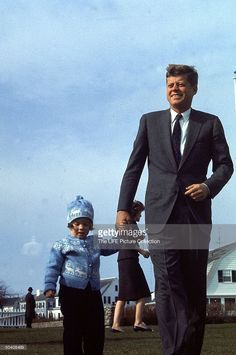 Presidential John F. Kennedy (R) w. daughter Caroline (L) outside family's home on Election Day.