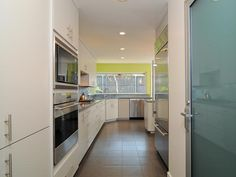 White Contemporary Galley Kitchen in Beautiful, Efficient Kitchen Design and Layout Ideas from HGTV