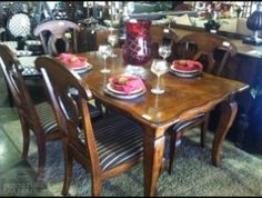 Beautiful 5 piece French country dining set. Includes table and four chairs. The chairs have black and white striped upholstery.
