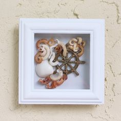 Seashell Beach Decor Wheel framed with glass by by SEASTYLE. $19.00, via Etsy.