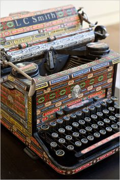 old typewriter covered in old cigar labels.