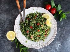 Quinoa Tabbouleh Salad - lemony Middle Eastern tabbouleh salad with healthy gluten free quinoa, fresh parsley and mint. Kosher for Passover. | ToriAvey.com #tabbouleh #salad #tabouli #tabbouli #sidedish #healthy #lemon #easyrecipe #vegetarian #cleaneating #kosher #passover #parsley #mint #tomatoes #oliveoil #evoo #lebanese #middleeastern #vegan #healthy #recipe