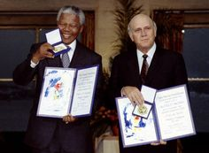10 December South African President FW de Klerk and African National Congress leader Nelson Mandela hold up medals and certificates after they were jointly awarded the 1993 Nobel Peace Prize Nelson Mandela Pictures, African National Congress, First Black President, Nobel Prize Winners, Black Presidents, Apartheid, Nobel Peace Prize, African History, World History