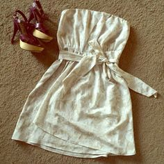 NWOT Express strapless dress Very pretty neutral colored dress that would look great with a pop of color ( shoes, purse) it is a size 10 and is NWOT Express Dresses Mini