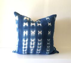 Vintage Indigo Mudcloth Pillow Cover, Indigo textiles from Burkina Faso, West Africa, Shibori, Resist-dyed, Tie-dyed, Indigo, Blue, White  These pillows are made from vintage handwoven textiles from Burkina Faso, West Africa. The textiles are made from strip-woven cotton thats shibori-dyed with natural indigo. Each textile is unique unto itself and the designs and colors may vary slightly. The designs on the textiles Id chosen looks somewhat like xs, os, or butterflies. There may be areas…