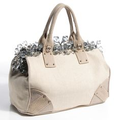 This is an authentic PRADA Canvas Mistolino Medium Crystal Cluster Frame Bag  in Naturale. This stylish tote is crafted of sturdy natural canvas. 59c04a31ae