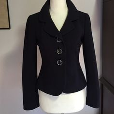 """Ann Taylor Navy Blue Jacket- SZ 0P Impeccably tailored jacket with gorgeous 3 button closure! Tag says 0 Petite, but my mannequin is a Med & it fits perfectly. Measures armpit to armpit-16"""" / Waist 15"""" & length is 20"""" Ann Taylor Jackets & Coats Blazers"""