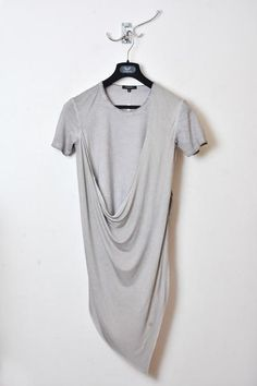 UNCONDITIONAL's signature short sleeve asymmetric drape double front t-shirt. Made in combination of cotton and rayon jerseys. Colour : Sand cold dye Product Code : T46 Care instructions : hand wash only, rinse in cold water, iron medium heat, do not bleach, do not tumble dry.
