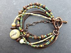 Ceramic bead strength, wood, leather, Czech glass and copper bracelet.