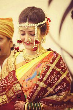 Lime and orange paithani silk saree embellished with floral weaves, styled with floral Mundavlya, nathni and Thushi necklace Marathi Bride, Marathi Wedding, Saree Wedding, Marathi Saree, Marathi Nath, Saree Hairstyles, Bride Hairstyles, Bridal Looks, Wedding Looks