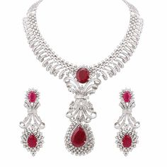 The Exclusive Fancy Diamond Necklace Set Studded With Round Diamonds, Marquise And Tappers & Baguettes With Changeable Centre-Piece Of Your Choice Along With Matching Designer Earrings. From Kuberz Diamondz, Hyderabad.