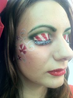 Cute decoration on the cheek! Not sure about those green brows though haha