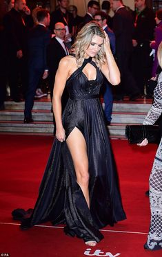 Legs for days: She paraded her bronzed and toned limbs in the revealing gown...