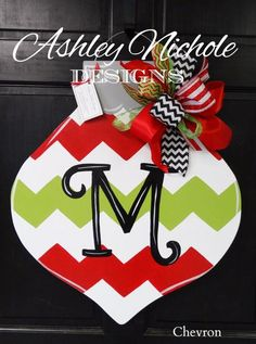 """Our chevron ornament is a cheery way to greet friends and family during the holiday season. Personalize it with your initial, last name, other. All door hangers are proudly hand painted in the USA. Made of 1/4"""" thick wood and painted on the back for a polished look.24"""" tall x 21"""" wide"""