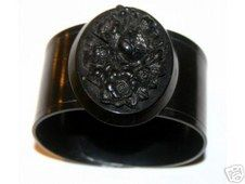 Victorian mourning bracelet. Celluloid cuff with vulcanite motif.
