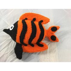"******This is a listing for the pattern only - not the finished item ******This is a pattern for an Angelfish named Angelica. She is 10"" long from the tip of her nose to the tip of her tail fin.She would be considered a confident beginner project but you should already have knowledge of working in the round and sewing amigurumi pieces together.You will need the following to complete your project: Red Heart Super Saver: carrot (50 grams) Bernat Super Value: Black (small amount) White felt 4…"