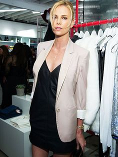 Star Tracks: Friday, November 21, 2014 | SHOP GIRL | Nothing 'nasty' about Charlize Theron or the simple, sexy outfit she wears Thursday to the Veuve Clicquot-sponsored store launch of the clothing chain Nasty Gal on Melrose Avenue in L.A.