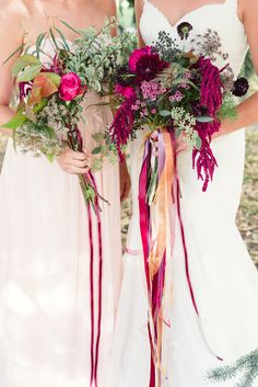 berry toned bouquets wrapped in ribbons