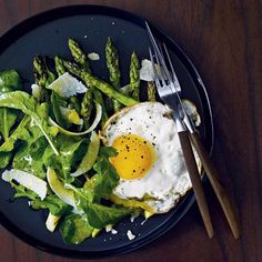 Grilled Asparagus Salad with Fried Eggs | Chef Mark Broadbent upgrades the standard lemony arugula salad by topping it with grilled asparagus, butter-fried eggs—duck eggs, when available—and freshly shaved Parmigiano-Reggiano.