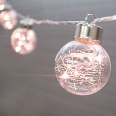 Add ornament string lights to your holiday setting or Christmas tree for a bright and festive design!