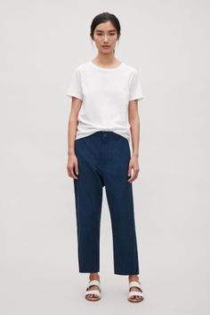 COS image 1 of Relaxed cotton chinos in Navy