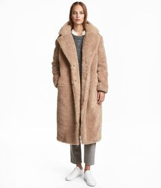 Beige. Long coat in pile with notched lapels, concealed snap fasteners at front, and side-seam pockets. Lined.