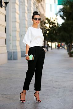 Classic: silk white blouse with black trousers